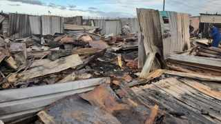 Last week a blazing fire in Freedom Park, Nomzamo, Strand left over 300 people destitute. Yesterday as the rest of the country celebrated Freedom Day, most of the residents still had not begun to rebuild their homes due to lack of resources. Picture: Supplied
