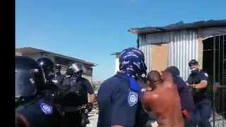 Law enforcement officers in Cape Town evicted a naked man from his informal dwelling in Khayelitsha. Picture: Screengrab