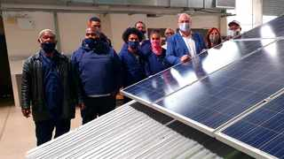 Learners from the skills development programmes at the South African Renewable Energy Technology Centre (SARETEC) with Economic opportunities and asset management mayco member James Vos.