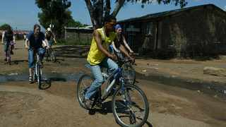 Lebo Malpa(yellow vest)cycles with tourists in Soweto. Picture: Bathini Mbatha
