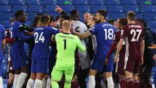 Leicester City and Chelsea players clash at the end of their Premier League game at Stamford Bridge on Tuesday. Photo: Catherine Ivill/Reuters
