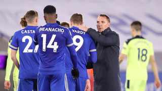 Leicester City's manager Brendan Rodgers (R) commiserates with striker Jamie Vardy after their loss to Newcastle. Photo: Alex Pantling/AFP