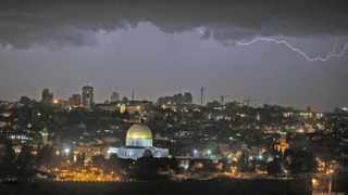 Lightning illuminates the sky over the Dome of the Rock in Jerusalem's Old City. Cosmic rays - another source of charged particles from exploding stars on the other side of the Universe - are thought to be another trigger for lightning.
