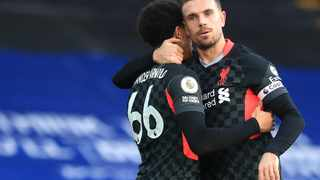 Liverpool captain Jordan Henderson celebrates with Tren Alexander-Arnold after scoring their fourth goal in their Premier League game against Crystal Palace at Selhurst Park in London on Saturday. Photo: Adam Davy/Reuters