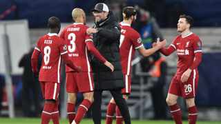 Liverpool manager Jurgen Klopp and players react at the final whistle in their win over RB Leipzig. Photo: (Photo by Attila Kisbendek/AFP