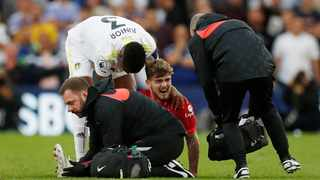 Liverpool's Harvey Elliott receives medical attention after sustaining an injury against Leeds United. Picture: Lee Smith/Action Images via Reuters