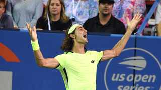 Lloyd Harris celebrates his win over Rafael Nadal at the Citi Open. Photo: Mitchell Layton/Getty Images via AFP