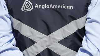Logo of Anglo American is seen on a jacket of an employee of the Los Bronces copper mine, in the outskirts of Santiago