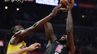 Los Angeles Clippers forward Montrezl Harrell, right, shoots as Los Angeles Lakers guard Isaac Bonga defends during the first half of an NBA basketball game in April last year. Photo: Mark J. Terrill/AP
