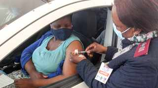 Louisa Menqesi receives her vaccine from professional nurse Lydia Mamashela at Zwartkops Raceway. A survey found nearly four in 10 (39%) of young African men and women polled would probably not, or definitely would not, take the vaccine. Picture: Jacques Naude/African News Agency (ANA)