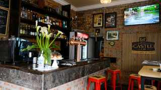"""Lynrae October and her fiance Michael Anthony from Elfindale are the new owners of the Castle Hotel Bar in District Six and are calling for families affected by the forced removals to share their stories to be displayed on a """"wall of remembrance"""" for all patrons to view."""