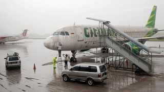MAN with Covid-19 boards Citilink flight as his wife. Picture: Dwi Oblo