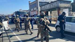 MEMBERS of the SANDF outside the Verulam Magistrate's Court as seven suspects appear for murders in Phoenix during the unrest. | Screen grab.