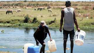 Madala Car Wash workers collect water in the river near Faure Road in Mfuleni. Many people in surrounding areas use the water amid restrictions. Picture Ayanda Ndamane/African News Agency (ANA)