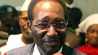 Mali's interim President Dioncounda Traore speaks upon his arrival at the Bamako airport.