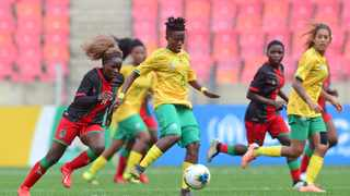 Mamello Makhabane of South Africa plays the ball ahead of Madyina Nguluwe of Malawi during their COSAFA Womens Championship semi-final at the Nelson Mandela Bay Stadium in Gqeberha on Thursday. Photo: Ryan Wilkisky/BackpagePix