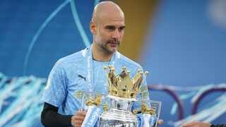 Manchester City manager Pep Guardiola celebrates with the trophy after winning the Premier League title. Photo: Dave Thompson/Reuters
