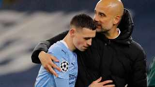 Manchester City manager Pep Guardiola embraces Phil Foden during their Champions League second leg semi-final. Picture: Phil Noble/Reuters