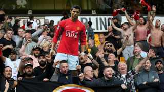 Manchester United fans celebrate with a cardboard cut out of Cristiano Ronaldo after their match against Wolverhampton Wanderers at Molineux Stadium in Wolverhampton on Sunday. Photo: Carl Recine/Reuters