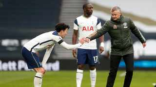 Manchester United manager Ole Gunnar Solskjaer bumps fists with Tottenham Hotspur's Son Heung-min after their Premier League match at the Tottenham Hotspur Stadium in London on Sunday. Photo: Matthew Childs/Reuters