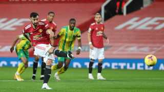 Manchester United's Bruno Fernandes scores from the penalty spot during their Premier League game against West Bromwich Albion at Old Trafford on Saturday. Photo: Catherine Ivill/Reuters