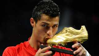 Manchester United's Cristiano Ronaldo kisses the golden boot trophy awarded to him as 'FIFPro Player of the Year 2008'. Picture: Toby Melville/Reuters
