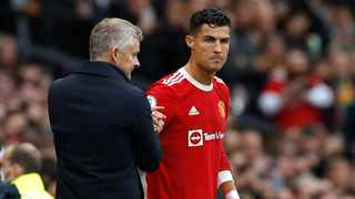 Manchester United's Cristiano Ronaldo shakes hands with manager Ole Gunnar Solskjaer before being brought on as a substitute during their Premier League game against Everton at Everton. Photo: Phil Noble/Reuters