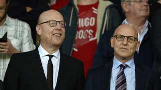 Manchester United's Joel Glazer, right, with his brother and fellow co-chairman Avram Glazer. Photo: Oli Scarff/AFP