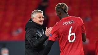 Manchester United's manager Ole Gunnar Solskjaer congratulates Manchester United's French midfielder Paul Pogba after the UEFA Europa League semi-final, first leg. Photo: Paul Ellis/AFP