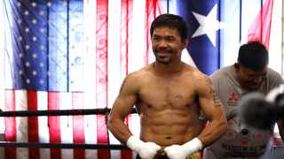 Manny Pacquiao poses for media at Wild Card Boxing Club ahead of his fight against Errol Spence Jr. Photo: Michael Owens/Getty Images via AFP