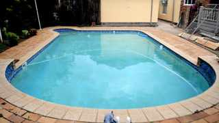 Manual topping up of swimming pools is allowed only if the pool is fitted with a pool cover. File Photo: Thobile Mathonsi
