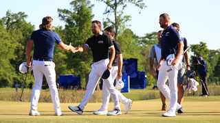 Marc Leishman of Australia and Cameron Smith of Australia shake hands with Louis Oosthuizen of South Africa and Charl Schwartzel of South Africa going to a playoff on the 18th green during the final round of the Zurich Classic. Photo: Mike Ehrmann/Getty Images via AFP