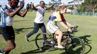 Marelize Horn getting a cycling lesson from the rising cyclist stars from the Velokhaya Life Cycling Academy team. Picture: Brendan Magaar/African News Agency(ANA)