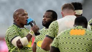 Mbongeni Mbonambi of South Africa takes a drink as Ox Nche looks on during the warm-up ahead of the first Test against the British and Irish Lions at Cape Town Stadium on Saturday. Photo: Ryan Wilkisky/BackpagePix