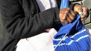 Member of the GOGO team and World War II veteran Kate Thabete knits a beanie hat for an Eskom project and gets money from this social hobby. Picture: Timothy Bernard 08.07.2011