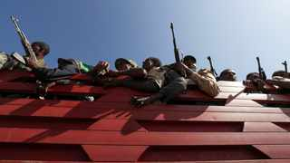 Members of Amhara region militias ride on their truck as they head to the mission to face the Tigray People's Liberation Front (TPLF) in Sanja near a border with Tigray, Ethiopia. Picture: Tiksa Negeri/Reuters