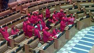 Members of the Economic Freedom Fighters stood their ground and refused to leave the National Assembly after being ordered to do so by Speaker Baleka Mbete. Photo: Sapa