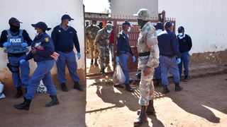 Members of the SANDF and SAPS deployed in Mamelodi go into the community looking for items looted during the civil unrest last week. Picture: Thobile Mathonsi/African News Agency (ANA)
