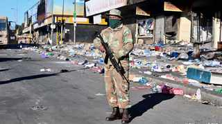 Members of the South African National Defence Force (SANDF) were deployed to quell looting and destruction of property in Alexandra township in Gauteng on Tuesday. Picture: Elmond Jiyane/GCIS