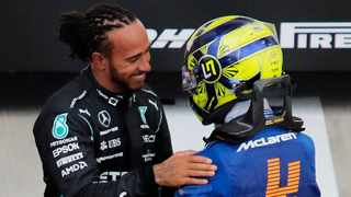 Mercedes' Lewis Hamilton celebrates after winning the race with McLaren's Lando Norris who finished seventh. Photo: Anton Vaganov/Reuters