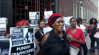 Mickey Meji, founder of the country-wide sex worker survivor movement, Kwanele, leads protesters outside the Durban High Court. Picture: Duncan Guy