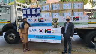 Minister Counsellor Bong-kyu Choi from the Embassy of the Republic of Korea in Pretoria delivered the face masks and disinfectant worth R 650,000 to Lebo Lebese at the South African Department of Health. Picture: Supplied