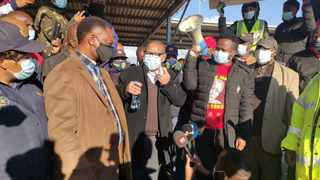 Minister of Higher Education, Science and Technology Dr Blade Nzimande, during a walkabout in Soshanguve yesterday, applauded the public for ensuring there was no looting in the area. Picture: Goitsemanfg Tlhabye