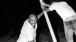 Morris Fynn with his saw during his campaign to cut down all beach apartheid signs in Durban in the 1970s.