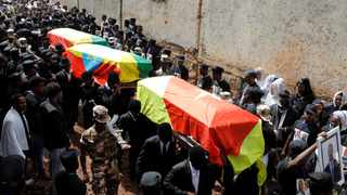 Mourners carry the coffin of Amhara president Mekonnen and two other officials during their funeral in the town of Bahir Dar. Picture: Reuters/Baz Ratner