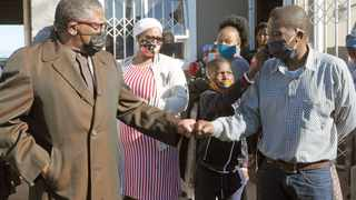 Mtobeli James, father of deceased Okuhle James, 21, who was shot and killed in a taxi violence-related incident on Friday. The distraught father greets Minister Fikile Mbalula who visited the family at home in Khayelitsha. Picture: Tracey Adams/African News Agency (ANA)
