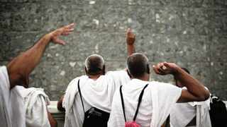 Muslim pilgrims cast stones at a pillar symbolizing the stoning of Satan, in a ritual called Jamarat, the last rite of the annual hajj, on the first day of Eid al-Adha, in Mina.