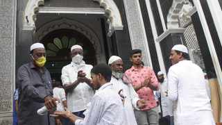 Muslims arriving to offer Friday prayers being provided with hand sanitiser before entering the mosque amid the coronavirus outbreak in Bengaluru, India, last month. Picture: IANS