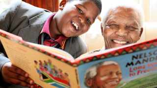 Nelson Mandela and his great-grandson, Ziyanda Manaway, reading the official childrens version of his best-selling autobiography Long Walk to Freedom. Photo: DEBBIE YAZBEK/NELSON MANDELA FOUNDATION