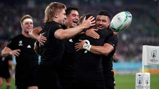 New Zealand's Aaron Smith (9) celebrates with teammates after scoring against Ireland. The All Blacks went on to win that game. Photo: Mark Baker/AP Photo